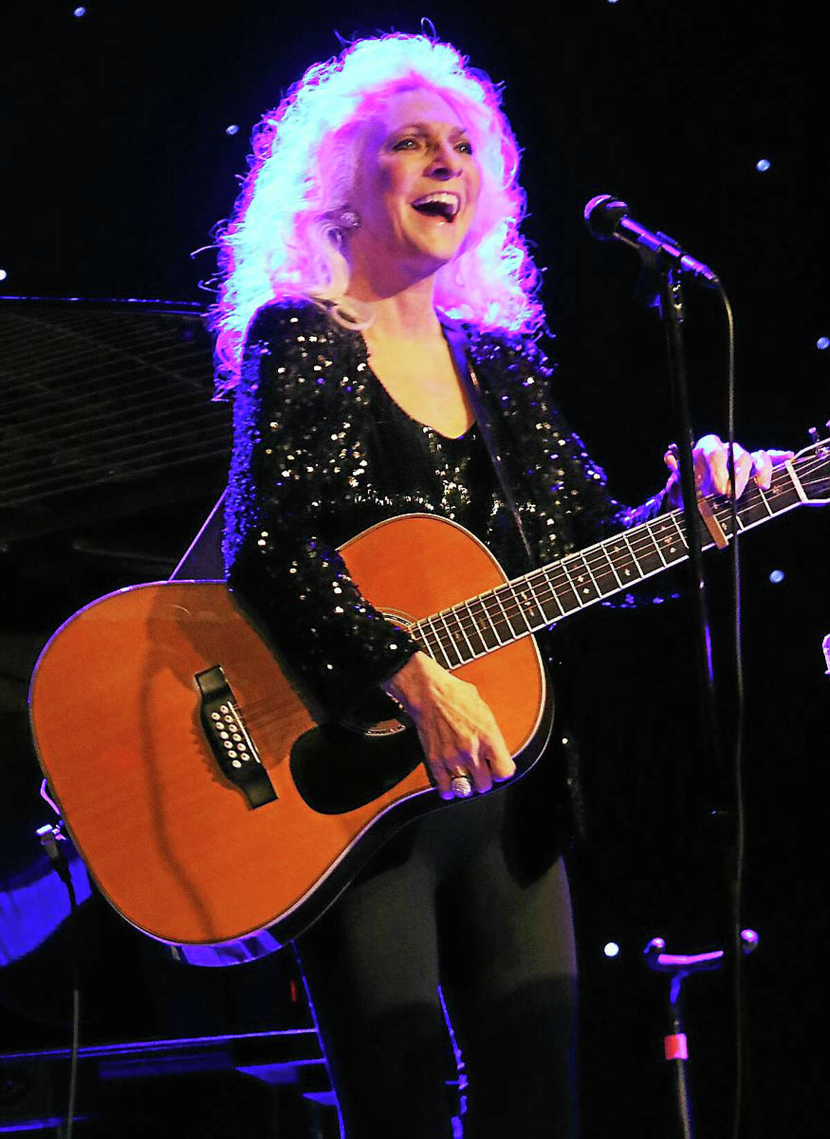 """Photo by John AtashianSinger, songwriter, guitarist and social activist Judy Collins is shown having fun with her fans during her performance at the Infinity Music Hall & Bistro in Hartford on Thursday Nov. 27. Collins' debut album """"A Maid of Constant Sorrow"""" was released in 1961, but it was her cover of Joni Mitchell's """"Both Sides, Now"""", the lead single from her 1967 album """"Wildflowers"""", that gave Collins worldwide attention. She entertained the capacity crowd with conversation and sa sampling of her biggest hits. Judy also played a sold-out show at the Infinity Music Hall & Bistro in Norfolk on Saturday Nov. 28. For future show listings, go to www.infinityhall.com"""