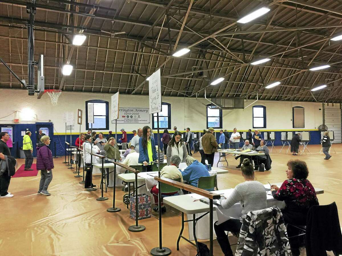 Ben Lambert - The Register CitizenTorrington residents cast ballots in the Armory on South Main Street Tuesday.
