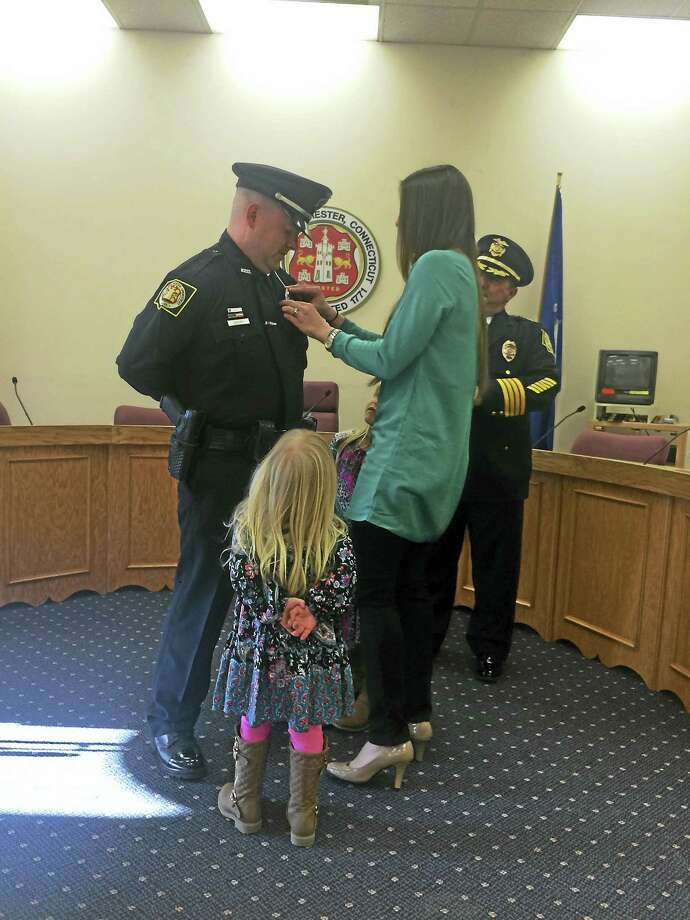 Bradley Kovacs is sworn in as a police officer with the Winchester Police Department. Photo: Noelia Ortiz — The Register Citizen