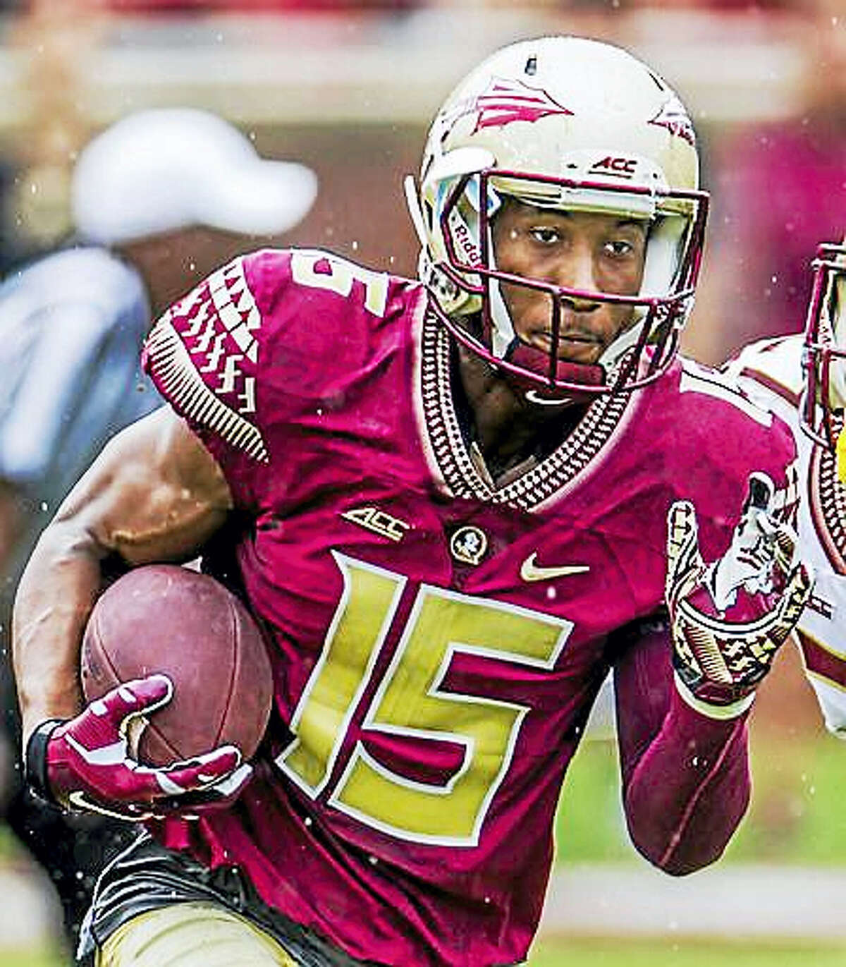 """In this April 11, 2015, file photo, Florida State wide receiver Travis Rudolph run in the first half of the Florida State Garnet & Gold spring college football game in Tallahassee, Fla. A small gesture of kindness by Florida State University wide receiver Travis Rudolph — captured in a photo and shared on Facebook — had tears streaming down the face of the sixth-grader's mother, Leah Paske. """"I'm not sure what exactly made this incredibly kind man share a lunch table with my son, but I'm happy to say it will not soon be forgotten,"""" she wrote."""