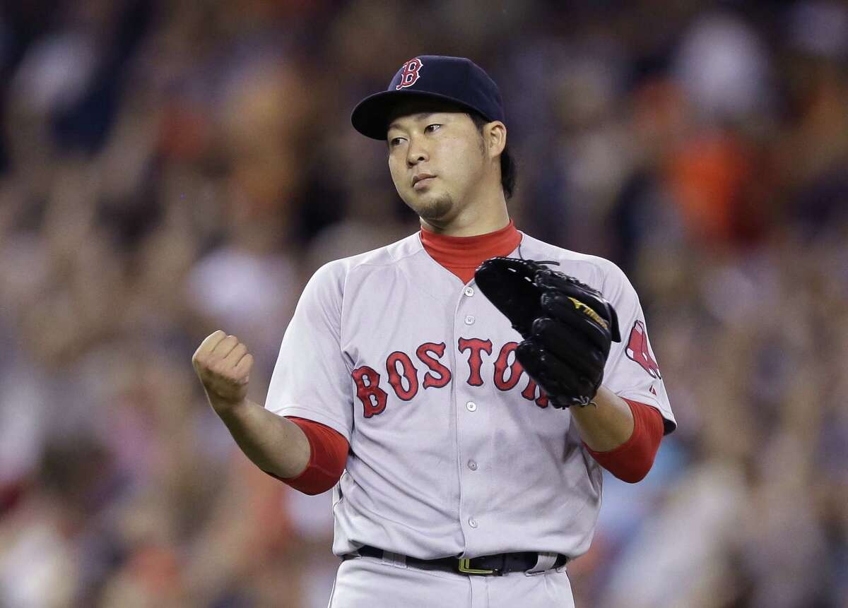 Red Sox relief pitcher Junichi Tazawa reacts after giving up a two-run home run to the Tigers' Victor Martinez during the seventh inning on Saturday.