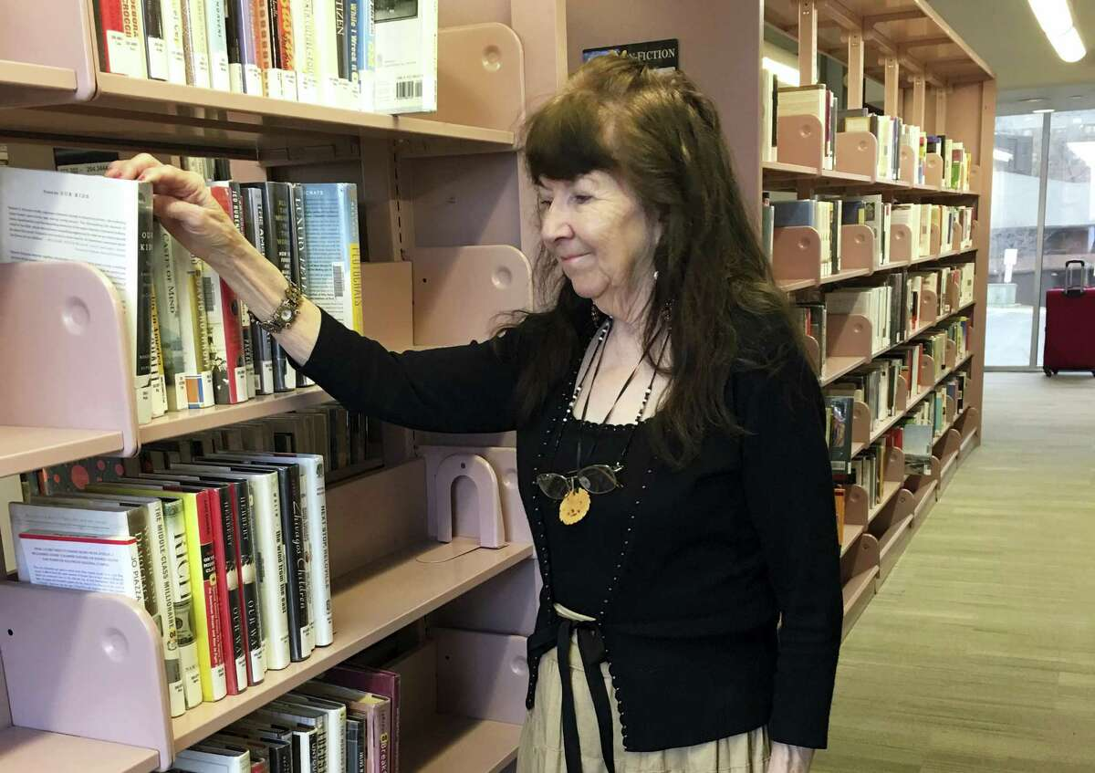 """Gloria Adamson, 81, is seen in Boulder, Colo. Adamson said she never planned to be working this late in life. """"I simply have to work, retirement isn't even in the picture to tell you the truth,"""" she says."""