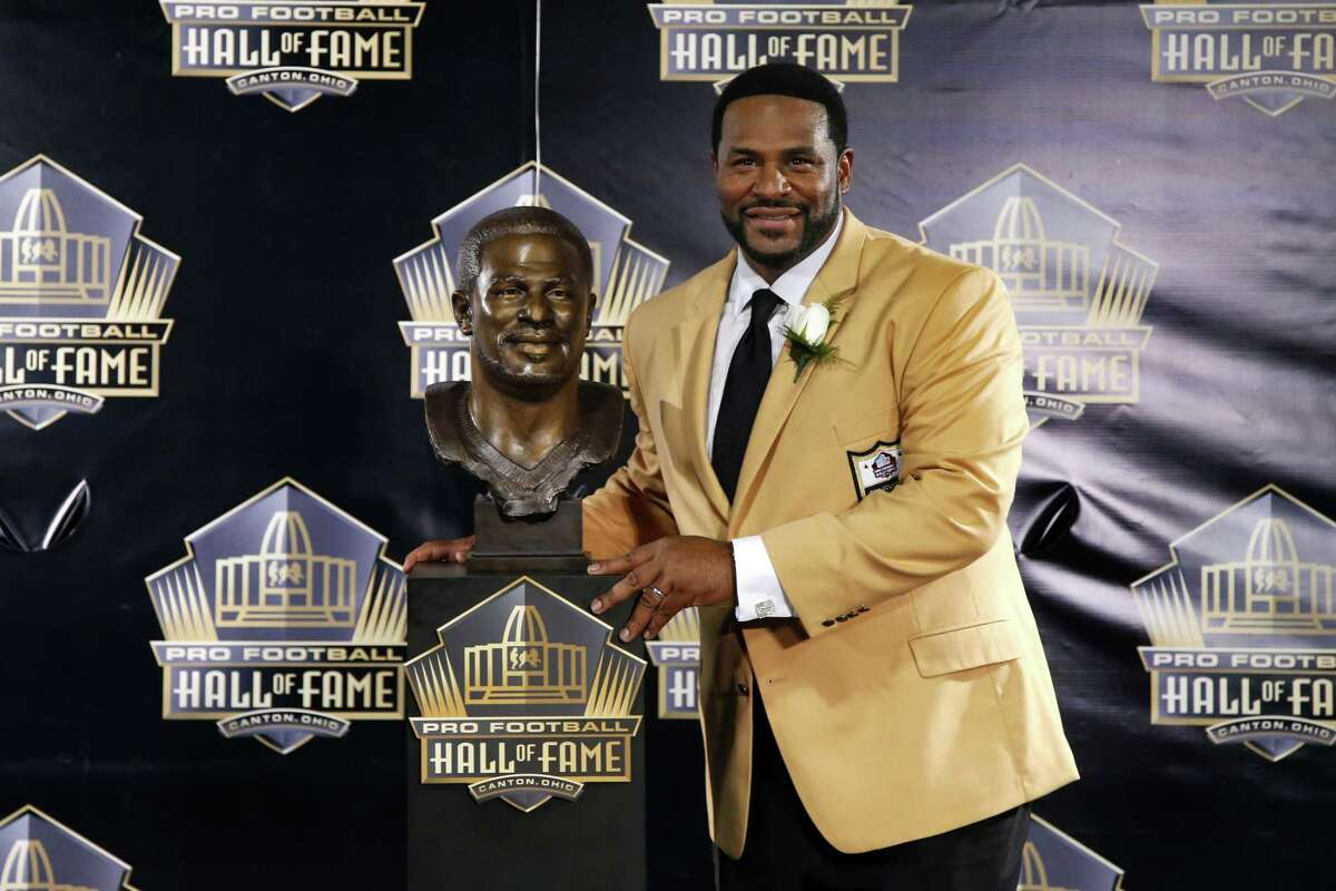 Jerome Bettis poses with his bust during the induction ceremony at the Pro Football Hall of Fame Saturday in Canton, Ohio.