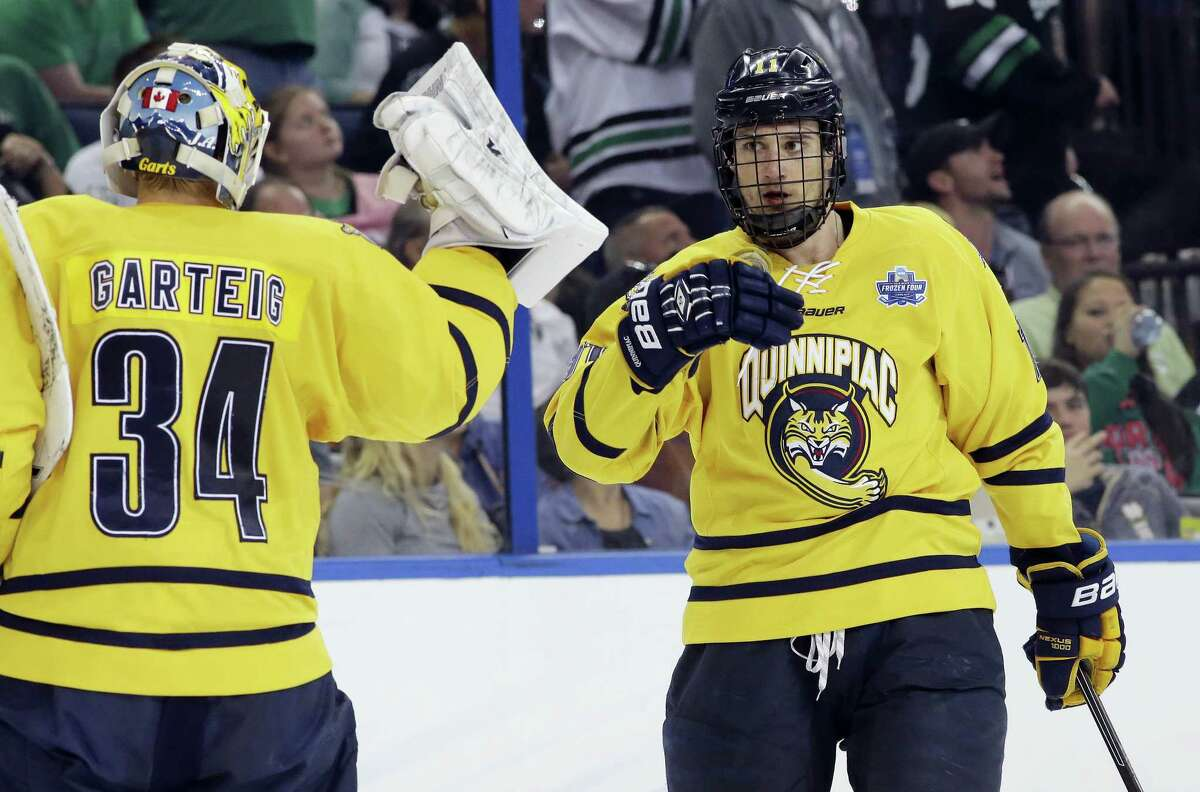 Quinnipiac forward Tim Clifton, right, announced on Friday that he will return for his senior season with the Bobcats.