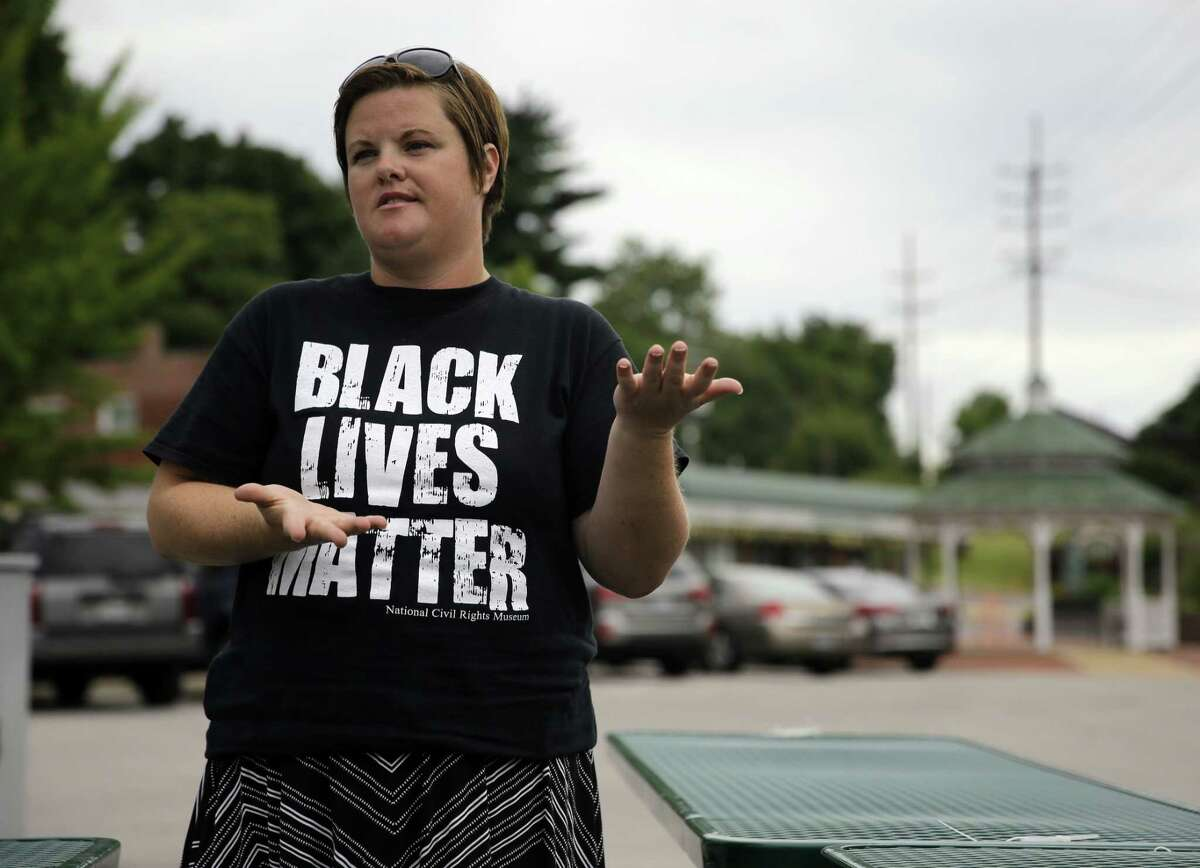 """In this July 22, 2015, Emily Davis speaks during an interview in Ferguson, Mo. Davis said she has seen little change for the better in the past year. """"People are still being targeted by police officers,"""" Davis said. """"If you talk to people who live on West Florissant, that is still happening. Our city government has not become any more communicative. They have not made any attempt to engage in dialogue — meaningful dialogue — with the citizens, which is not any different than it was a year ago."""""""