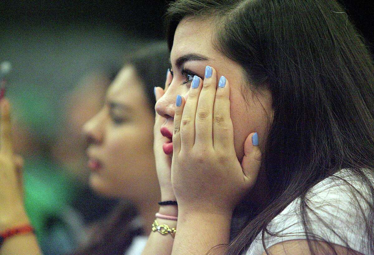 Ruth Lara watches her cousin Samuel Juarez with the Reynosa Little League pitch against Japan in the World Series on Saturday at the McAllen Convention Center. Reynosa lost 5-0.