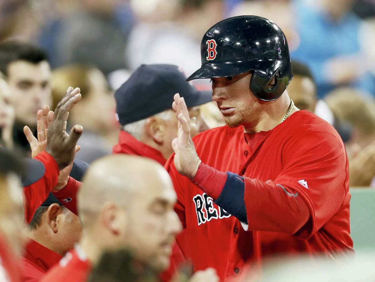 Christian Vazquez is congratulated after scoring on an RBI single by Dustin Pedroia.