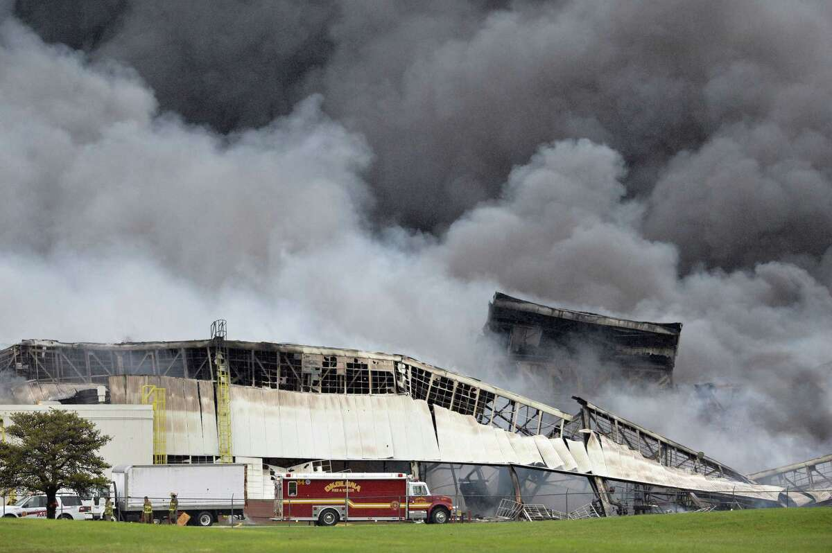 More than 120 Louisville firefighters continue to battle the blaze Friday in building six at the General Electric Appliance Park complex in Louisville, Ky.