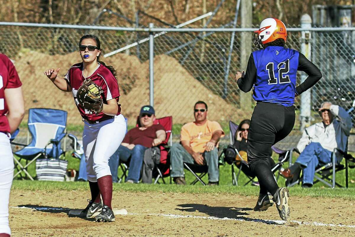 Photo by Marianne KillackeyCrosby's Nayarit Cora runs out a pop-up while Torrington first baseman Amanda Thiel watches the play in Torrington's mercy-rule-shortened win Friday.