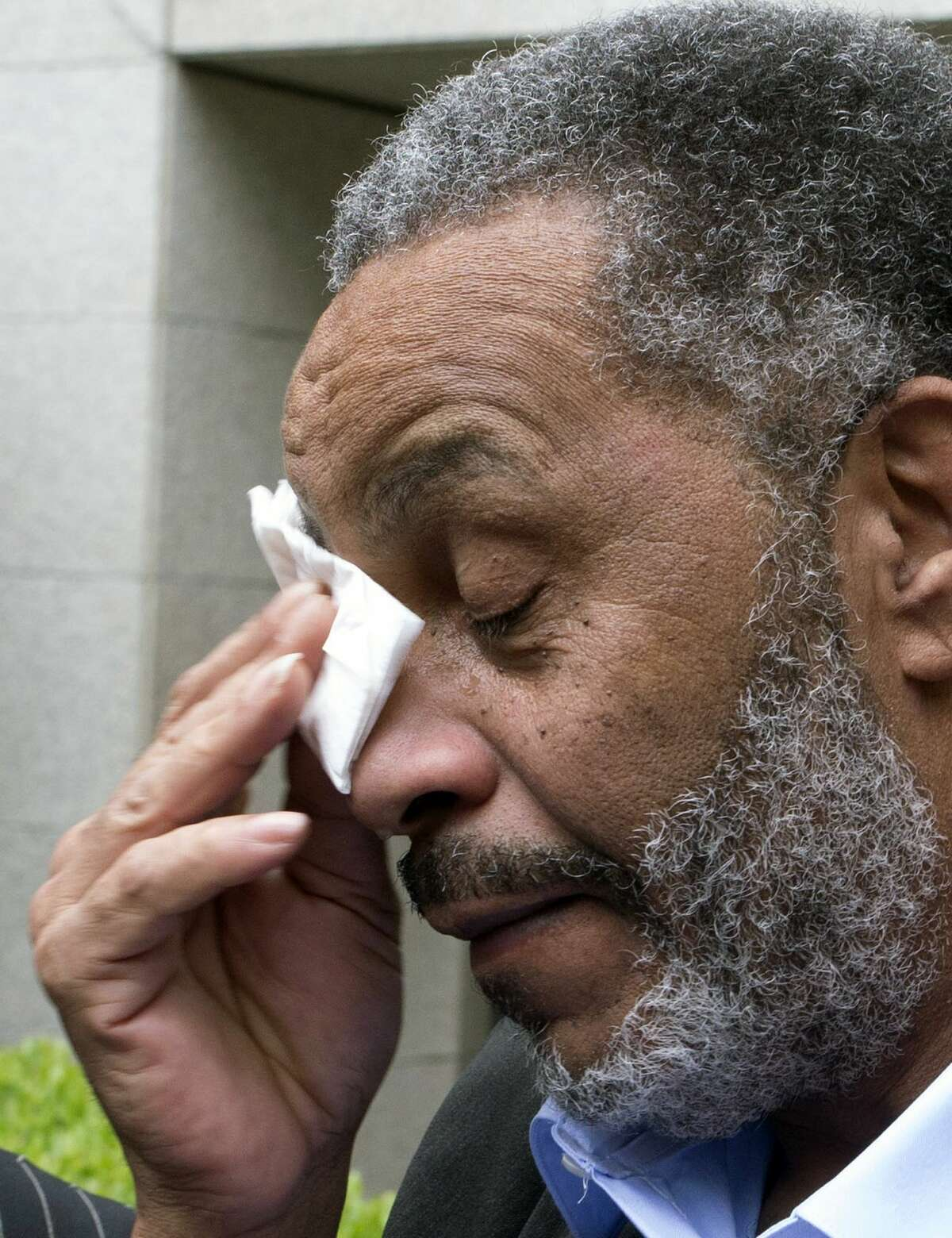 Anthony Ray Hinton wipes away tears after greeting friends and relatives upon leaving the Jefferson County jail, Friday, April 3, 2015, in Birmingham, Ala. Hinton spent nearly 30 years on Alabama's death row, and was set free Friday after prosecutors told a judge they won't re-try him for the 1985 slayings of two fast-food managers.