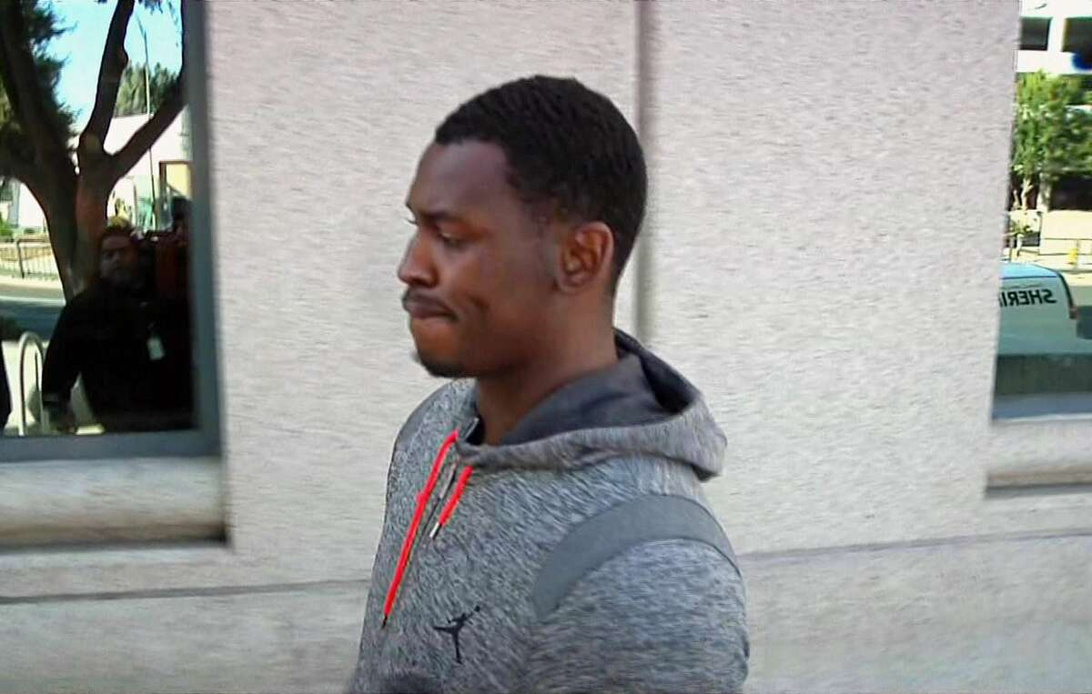 In this image made from video and provided by KNTV, former San Francisco 49ers linebacker Aldon Smith walks past cameras after being released from the Santa Clara County Jail on Friday in San Jose, Calif. Santa Clara Police arrested Smith on charges of hit and run, drunken driving and vandalism.