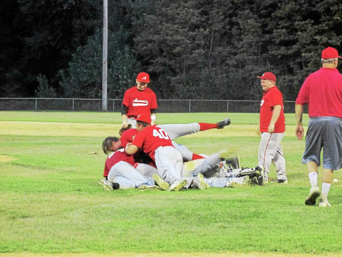 Amenia celebrates after defeating Torrington to win the Connie Mack Championship Thursday evening.