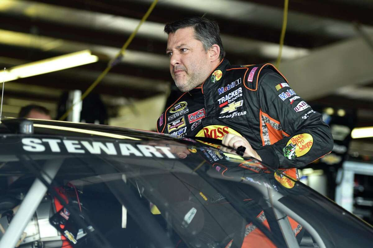 Tony Stewart climbs into his car before practice for Sunday's NASCAR Sprint Cup race at Watkins Glen International on Friday in Watkins Glen, N.Y.