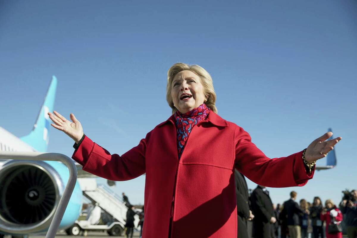 Democratic presidential candidate Hillary Clinton speaks to members of the media before boarding her campaign plane at Westchester County Airport in White Plains, N.Y. on Nov. 7, 2016, to travel to Pittsburgh.