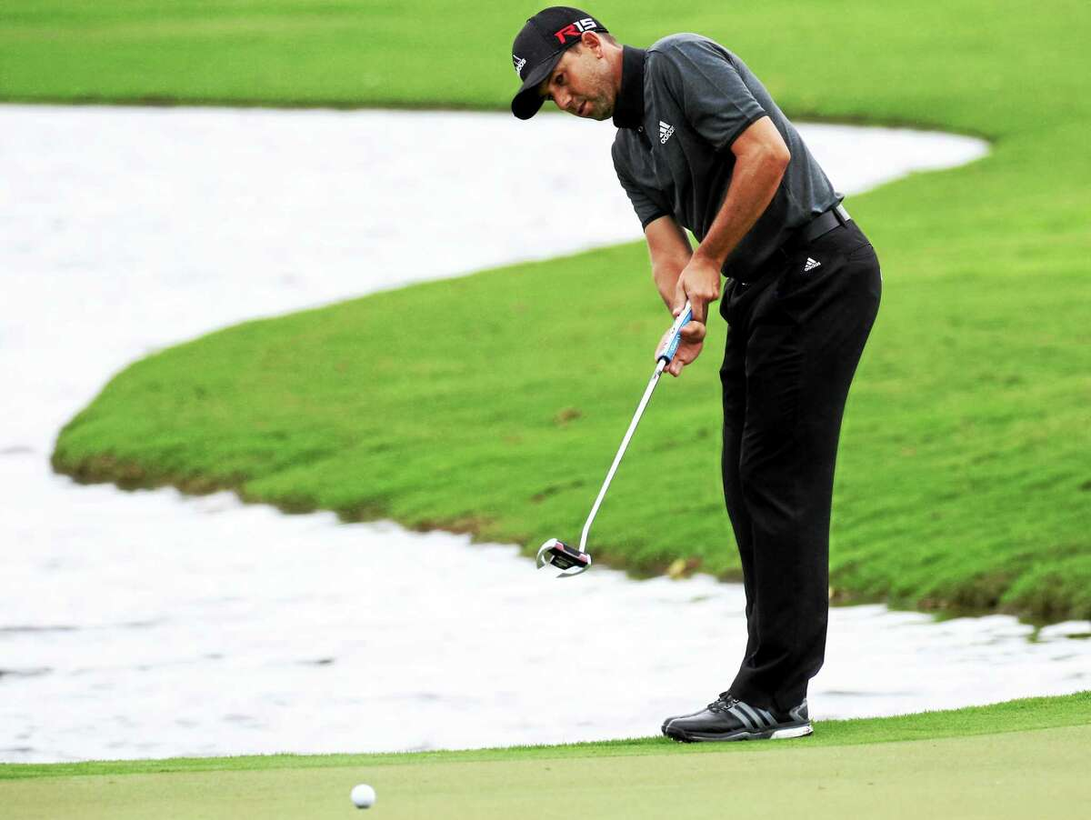 Sergio Garcia follow his shot on the seventh green during the final round of the Cadillac Championship on March 8 in Doral, Fla.