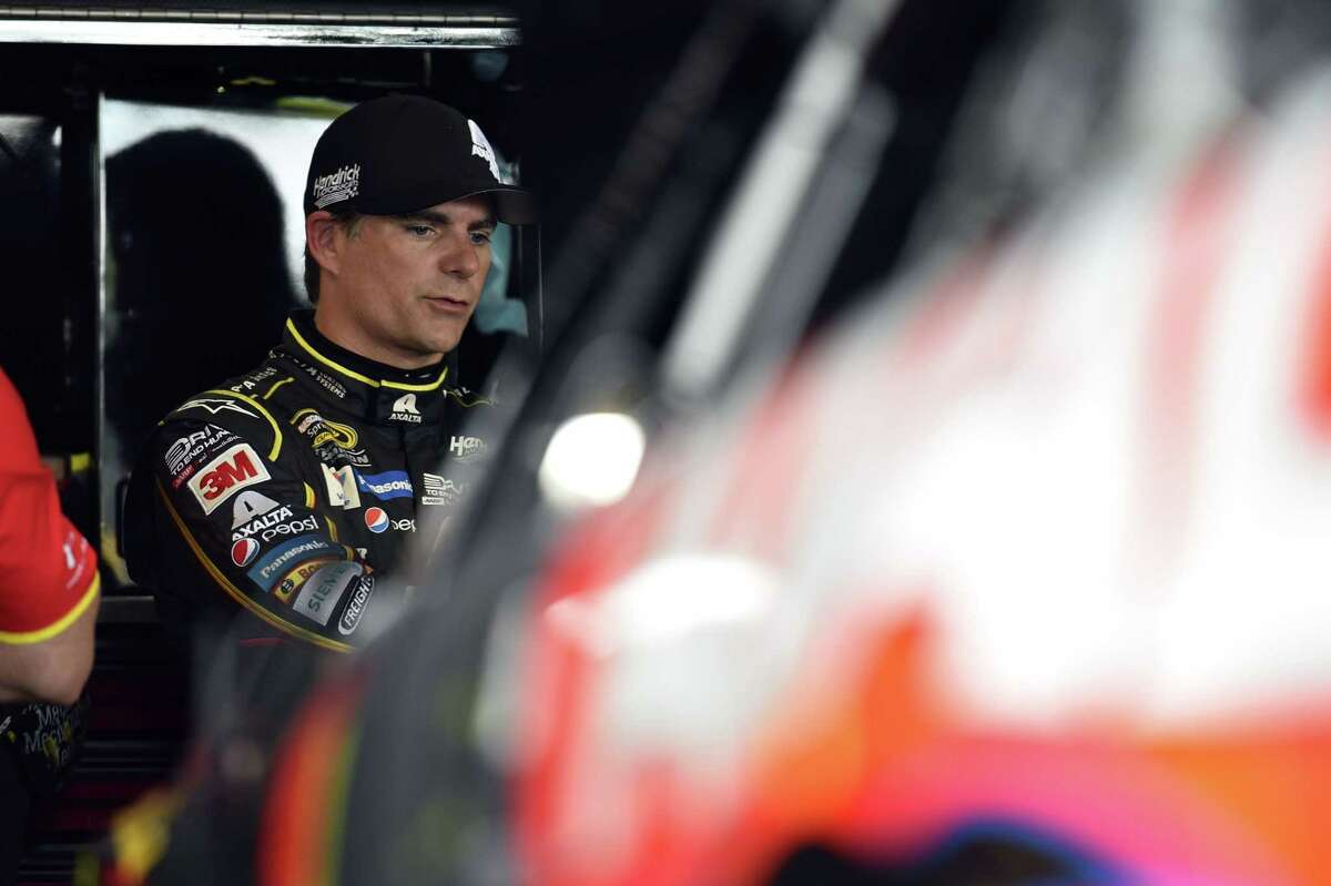 Jeff Gordon stands in the garage area during practice for Sunday's NASCAR Sprint Cup series auto race at Watkins Glen International on Friday in Watkins Glen, N.Y.