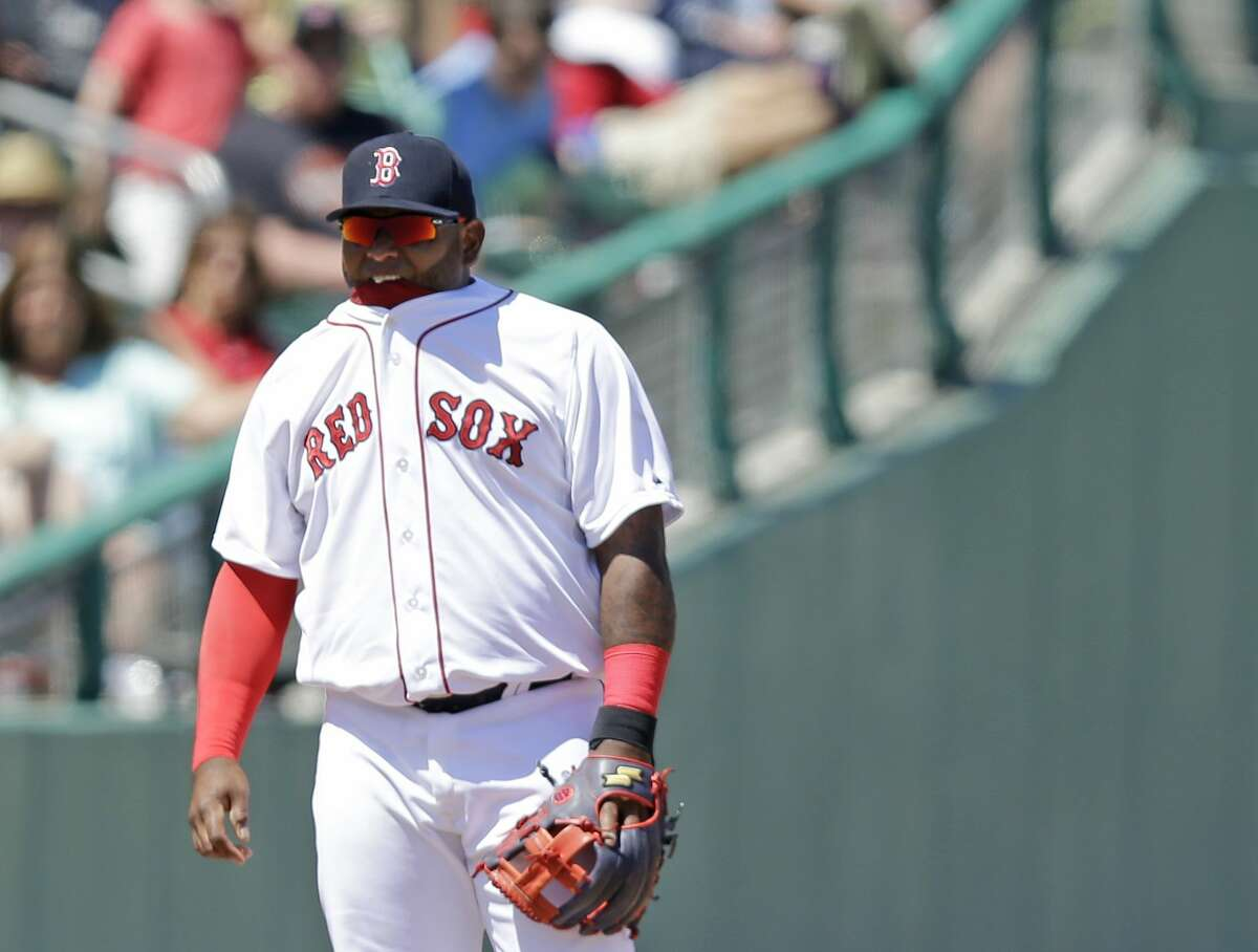 Boston Red Sox third baseman Pablo Sandoval bites on the collar of his shirt during a spring training game against the Tampa Bay Rays on Sunday in Fort Myers, Fla.