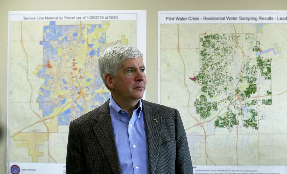 In this Feb. 18, 2016, file photo, Gov. Rick Snyder addresses the media in Flint, Mich. Michigan would have the toughest lead-testing rules in the nation and require the replacement of all underground lead service pipes in the state under a sweeping plan Gov. Rick Snyder and a team of water experts are unveiling Friday, April 15, 2016, in the wake of Flint's water crisis.
