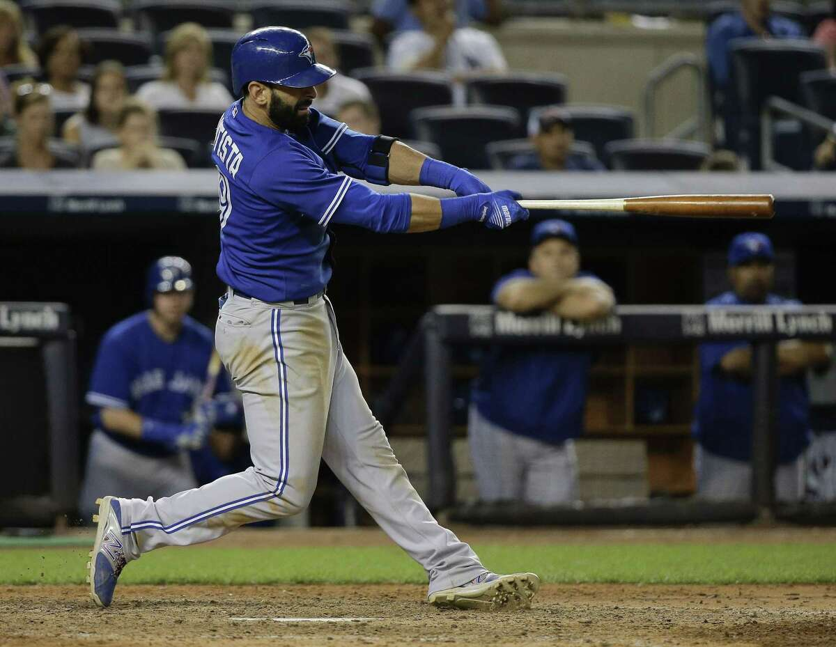 Blue Jays right fielder Jose Bautista follows through on a home run in the 10th inning on Friday.
