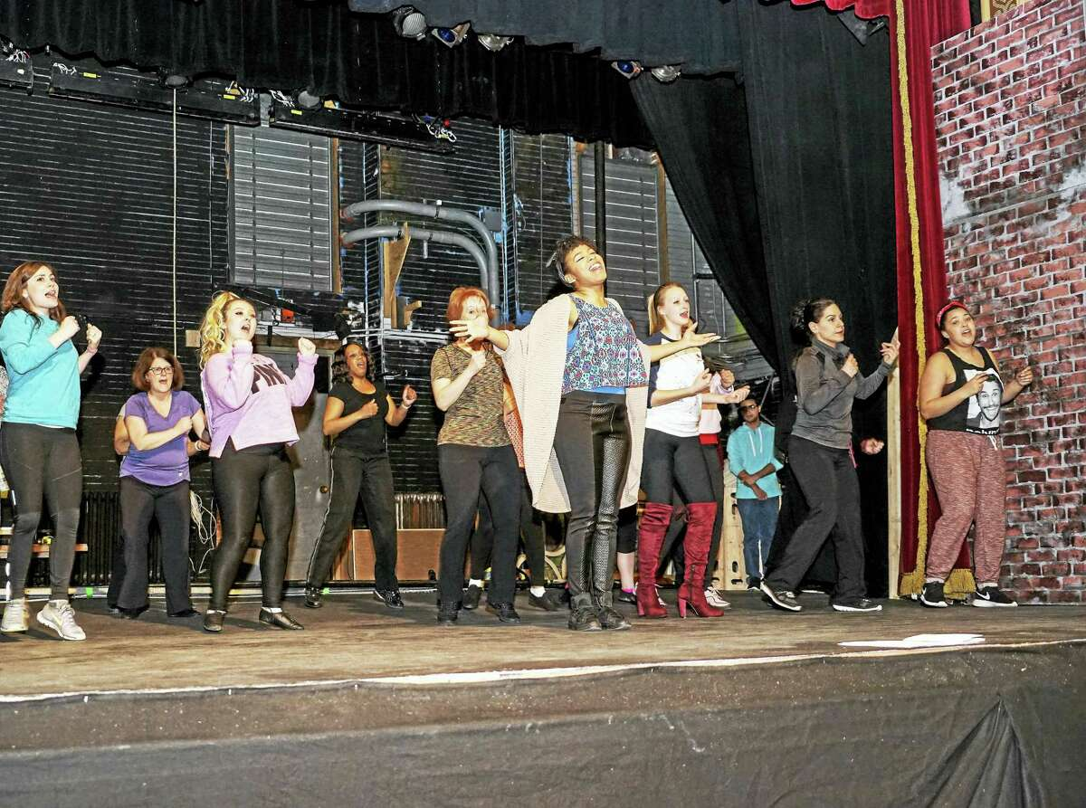 """Photo by Meghan StevensActors rehearse a musical number from """"Sister Act"""" performing April 16-May 1 at Landmark Community Theatre at the Thomaston Opera House, Thomaston, CT."""
