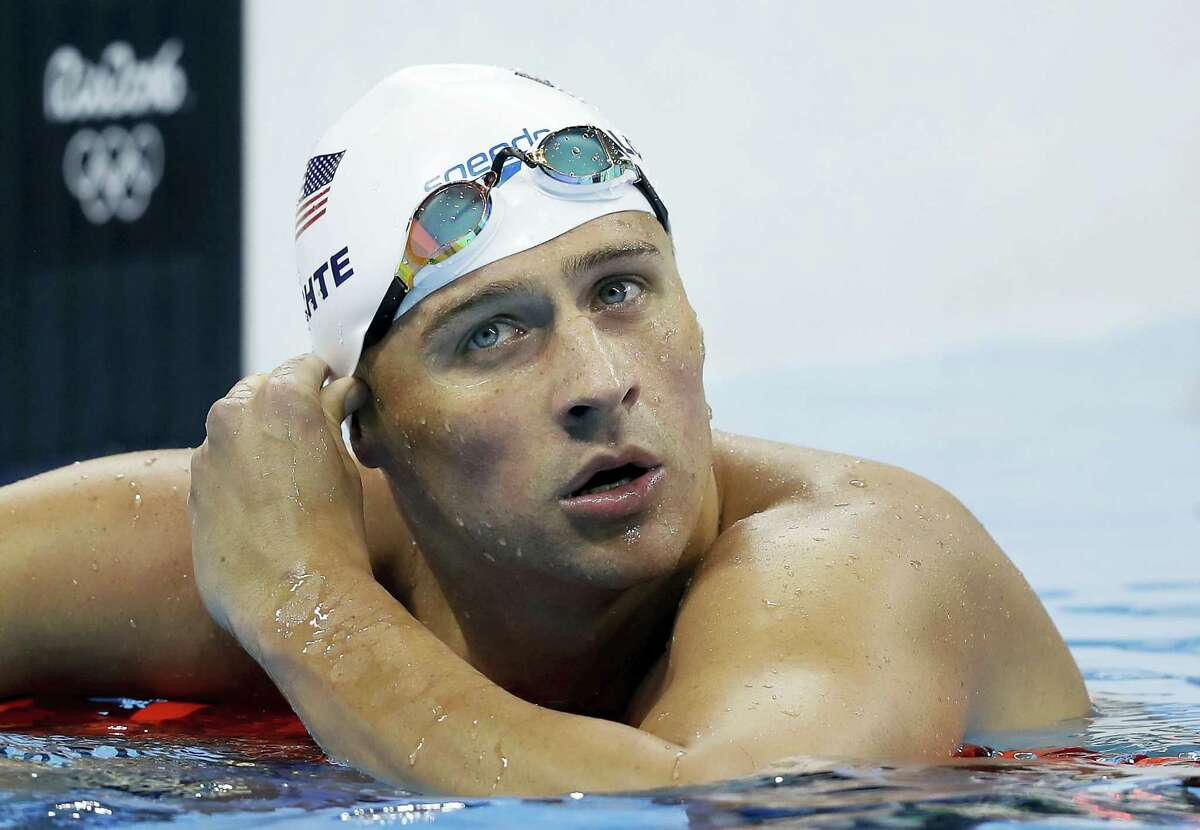 """In this Aug. 9, 2016 photo, United States' Ryan Lochte checks his time in a men's 4x200-meter freestyle heat during the swimming competitions at the 2016 Summer Olympics in Rio de Janeiro, Brazil. During an Aug. 30, 2016 appearance on ABC's """"Good Morning America,"""" Lochte wouldn't say whether he'd return to Brazil to face charges of filing a false police report over an incident at a gas station during the Games."""