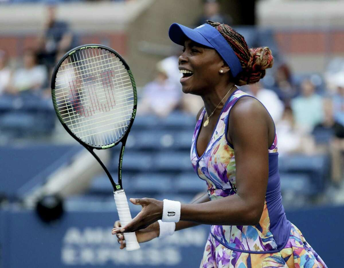 Venus Williams reacts after a shot to Kateryna Kozlova during the first round of the U.S. Open tennis tournament Tuesday. Williams won in three sets.