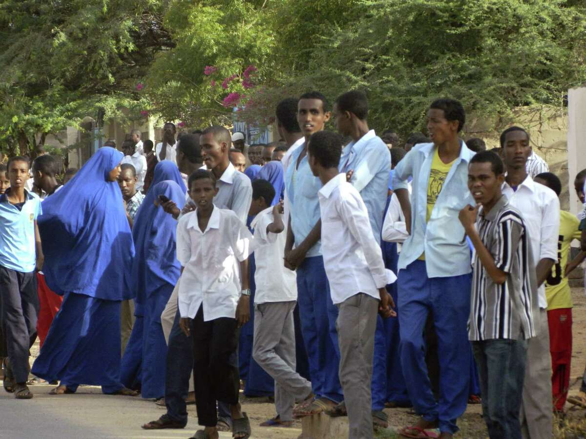 Students gather and watch from a distance outside the Garissa University College after an attack by gunmen, in Garissa, Kenya on April 2, 2015. Gunmen attacked the university early Thursday, shooting indiscriminately in campus hostels.