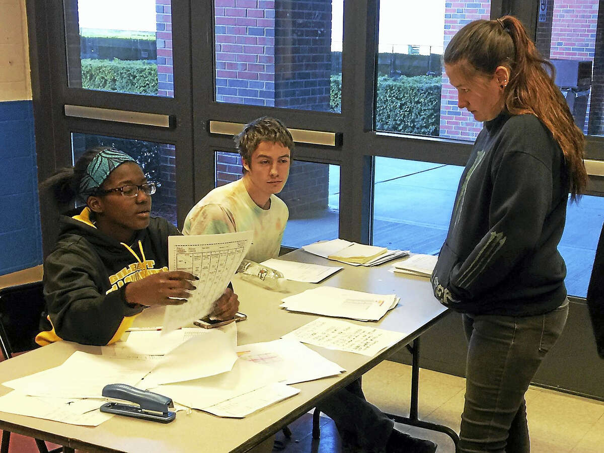 Ben Lambert - The Register Citizen A student turns in her ballot during the Gilbert School's mock election on Monday. More than 300 students cast ballots; Trump was the winner for president.