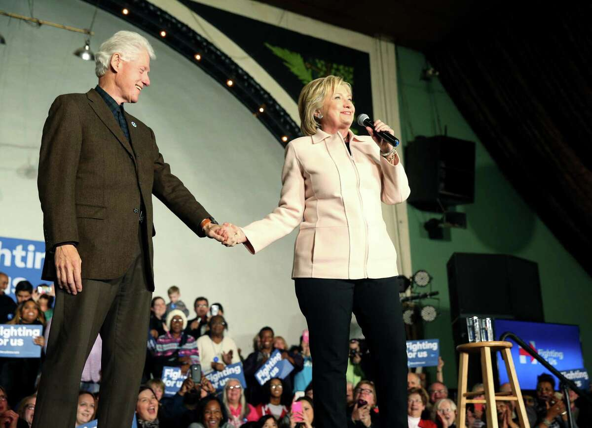 Democratic presidential candidate Hillary Clinton, accompanied by her husband, former President Bill Clinton, speaks at a rally at The Col Ballroom in Davenport, Iowa, Jan. 27.