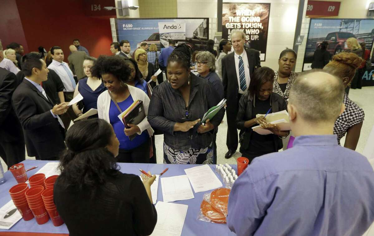 In this photo taken Wednesday, June 10, 2015, job seekers attend a job fair in Sunrise, Fla. The Labor Department reports on the number of people who applied for unemployment benefits the week ending Aug. 1 on Thursday, Aug. 6, 2015. (AP Photo/Alan Diaz)