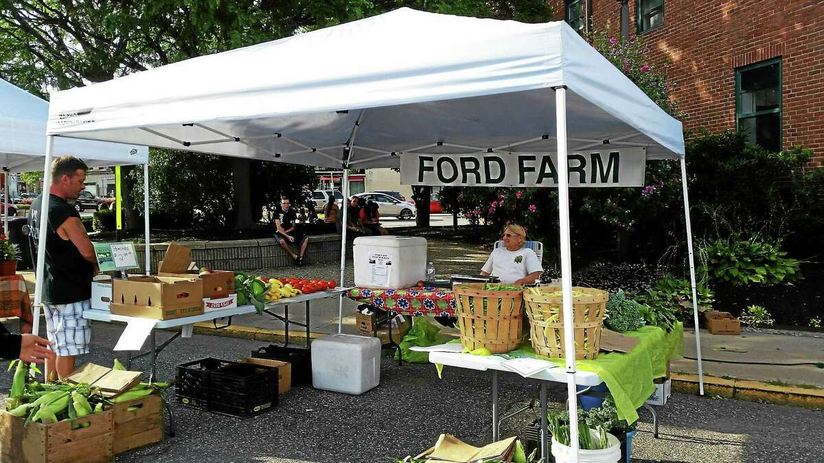 Carol Kranyik, of Ford Farm, sits at her booth during this past Thursday's Marketplace on Franklin Avenue.