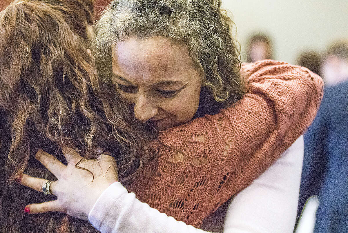 Jack McCullough's stepdaughter Janey O'Connor hugs her cousin Jenn Houton after Judge William Brady released McCullough and granted him a new trial during a hearing in the DeKalb County Courthouse on Friday, April 15, 2016 in Sycamore, Ill. McCullough who a prosecutor says was wrongly convicted in the 1957 killing of an Illinois schoolgirl was released Friday shortly after a judge vacated his conviction, meaning that one of the oldest cold cases to be tried in U.S. history has officially gone cold again.
