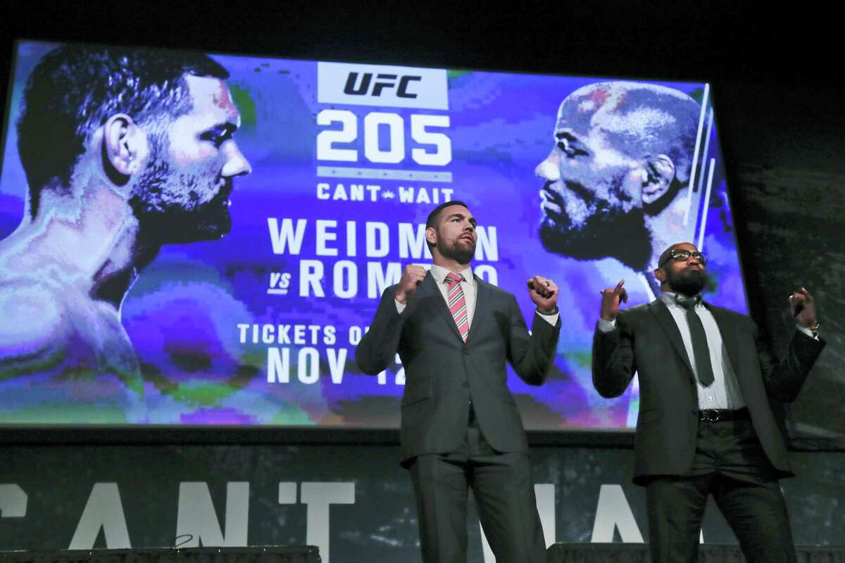 UFC middleweight fighters Chris Weidman, left, and Yoel Romero pose for photos during a news conference for UFC 205 in New York. Weidman and Romero are on the first major UFC card to be held in New York after the state legislature legalized the sport earlier in 2016.