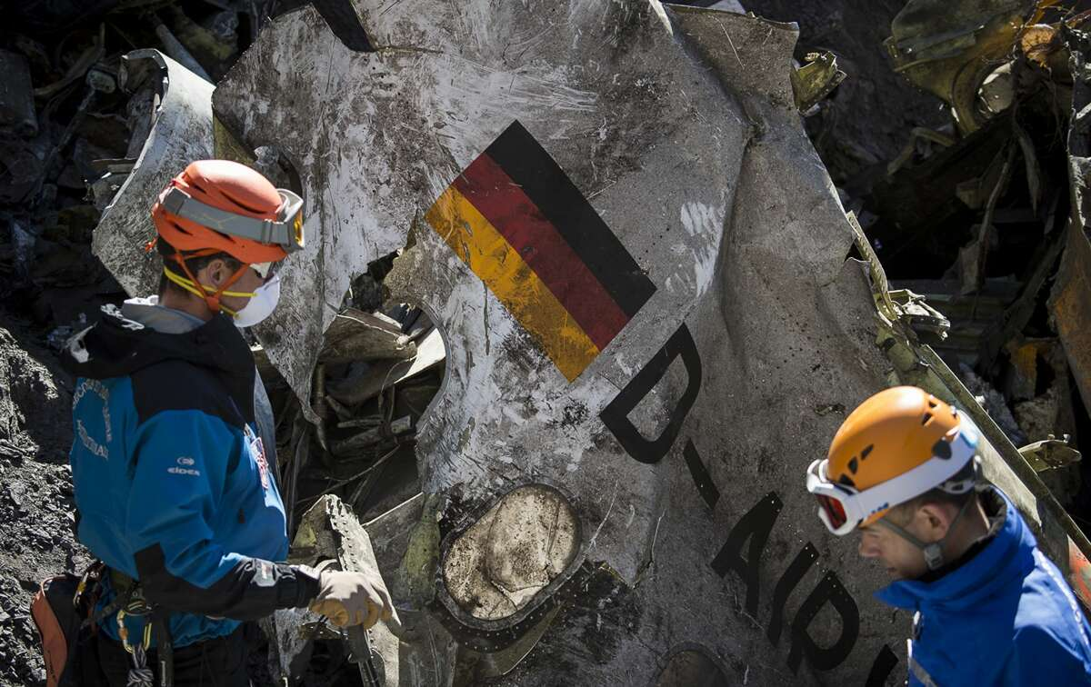 In this photo taken on March 31, 2015 and provided by the French Interior Ministry, French emergency rescue services work among debris of the Germanwings passenger jet at the crash site near Seyne-les-Alpes, France.