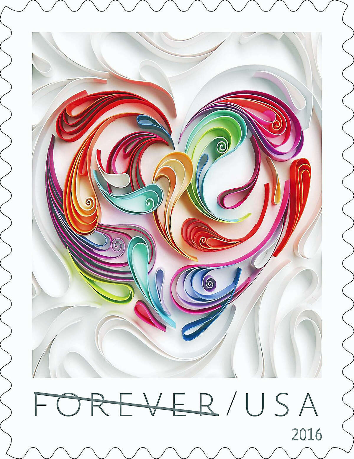 """The 2016 Love stamp — a Quilled Paper Heart Forever stamp. (The line through """"Forever"""" is no reflection on the love theme, said a postal spokesman; it's to prevent counterfeiting in this display only)."""