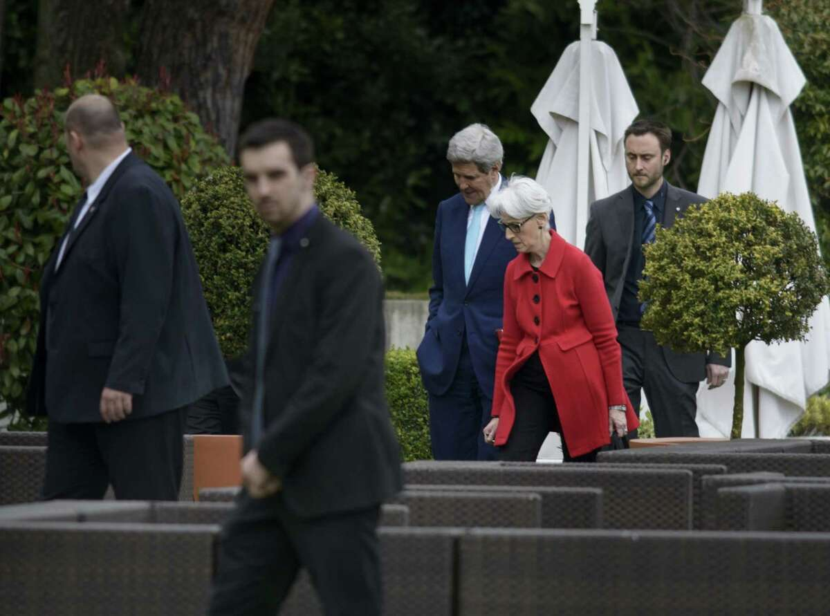 U.S. Secretary of State John Kerry, center and US Under Secretary for Political Affairs Wendy Sherman, centre right, as they walk in a courtyard, at the Beau Rivage Palace Hotel, during an extended round of talks on Iran's nuclear program on April 2, 2015, in Lausanne, Switzerland.