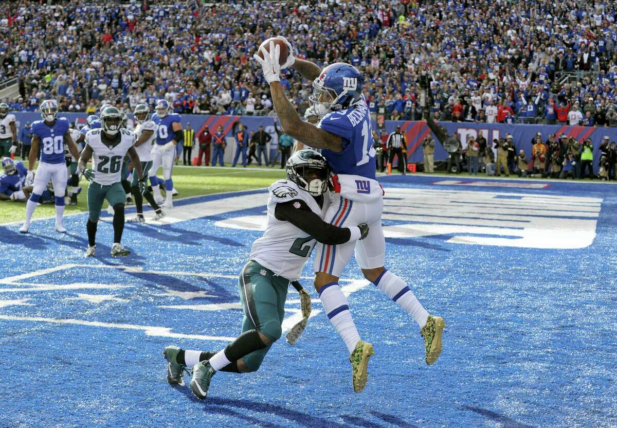 Giants wide receiver Odell Beckham catches a pass for a touchdown as he is hit by Eagles cornerback Leodis McKelvin during the second quarter Sunday.
