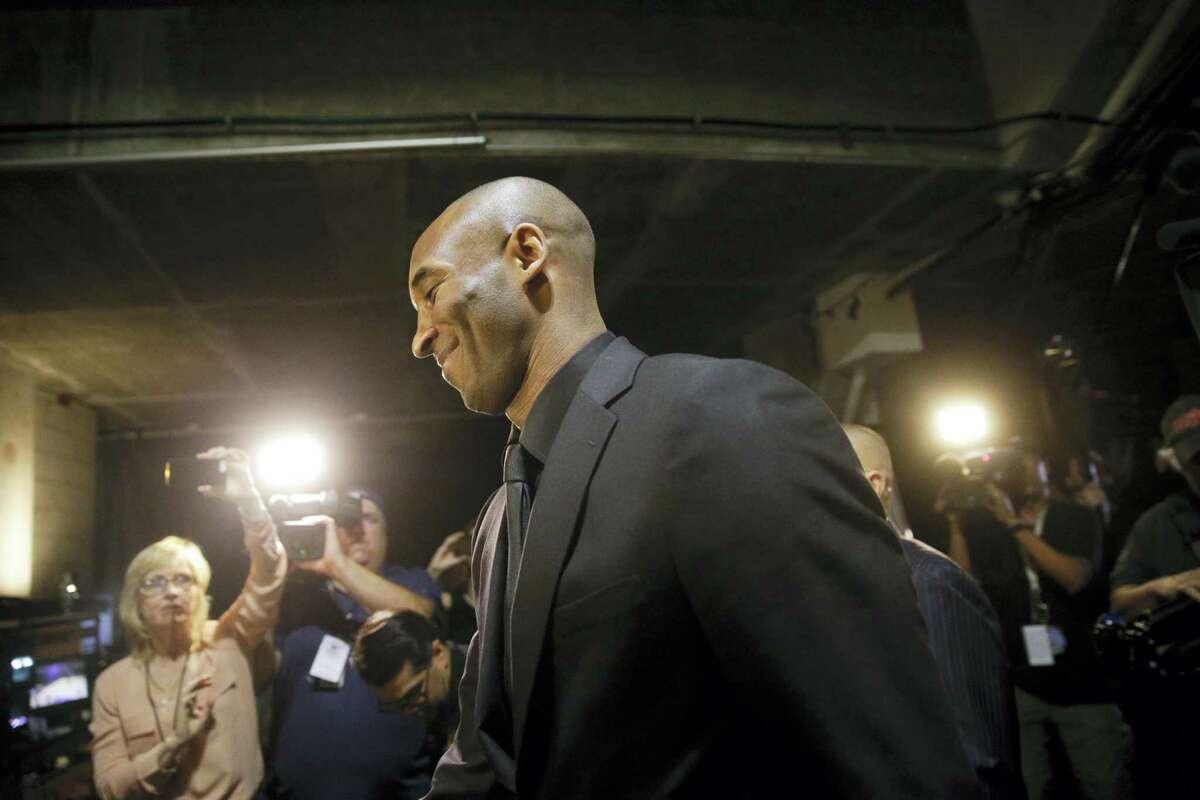 Los Angeles Lakers' Kobe Bryant smiles as he arrives for the last NBA basketball game of his career, against thw Utah Jazz on April 13, 2016, in Los Angeles.