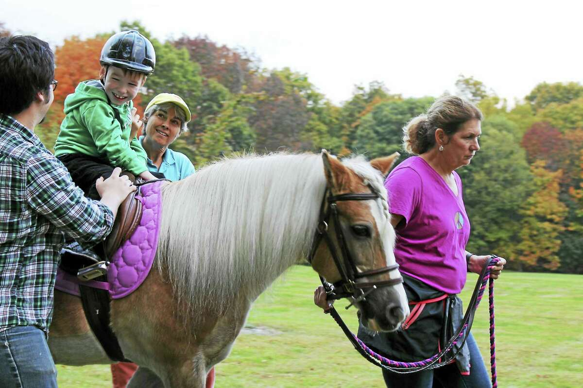 Contributed photo Little Britches provides therapeutic riding lessons to children with disabilities. Volunteers are needed to assist riders for the fall program, which begins Sept. 7.