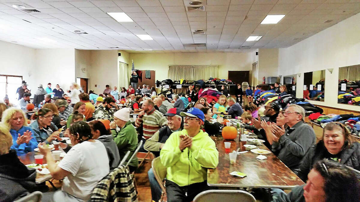File Photo - The Register Citizen Rally participants enjoy lunch at the Knights of Columbus hall at last year's event.