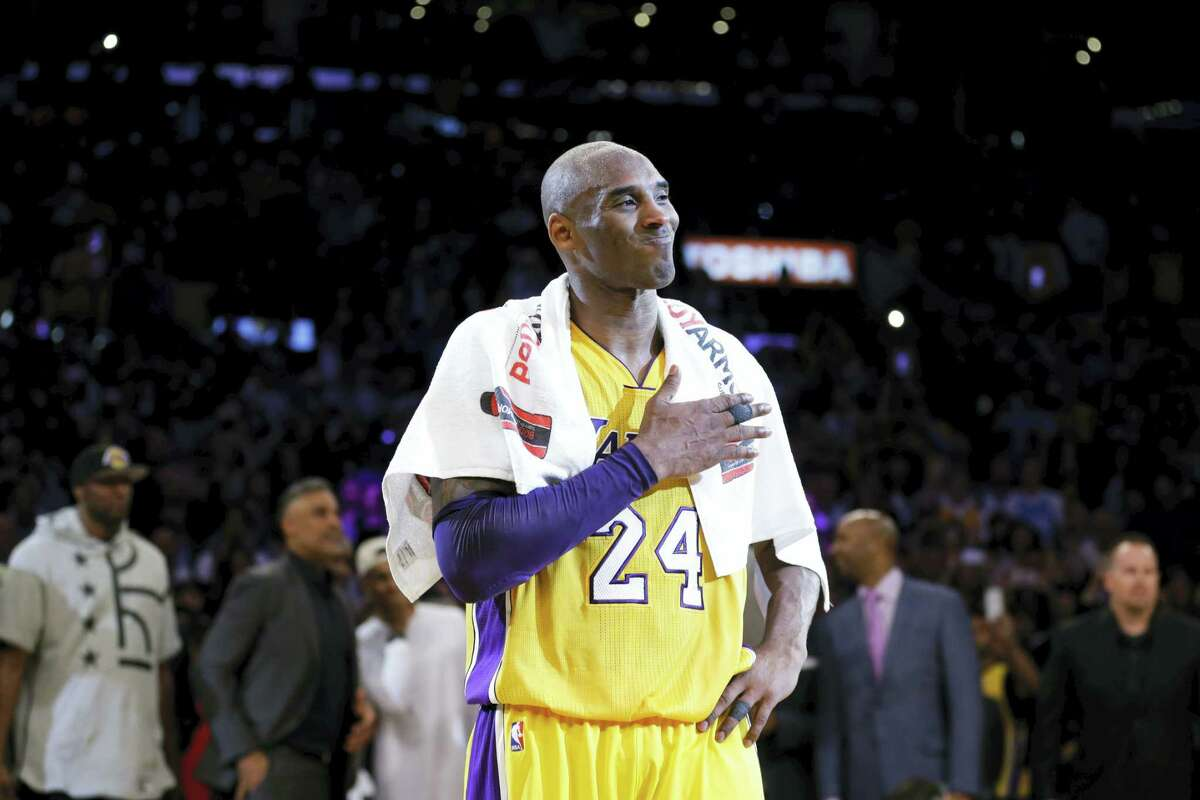 Kobe Bryant pounds his chest after playing the final NBA game of his career on Wednesday in Los Angeles.