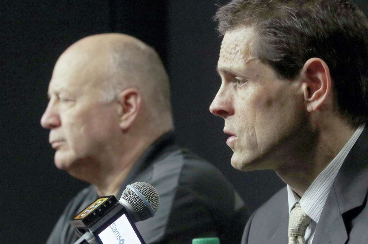 Bruins general manager Don Sweeney, right, speaks alongside head coach Claude Julien at a news conference Thursday in Boston.