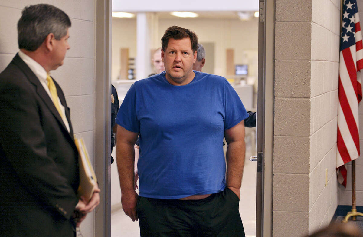 Todd Kohlhepp is escorted into a Spartanburg County magistrate courtroom on Nov. 4, 2016 in Spartanburg, S.C. Kohlhepp, a 45-year-old registered sex offender with a previous kidnapping conviction, appeared at a bond hearing Friday on a kidnapping charge in connection to a woman being found chained inside a storage container on a property in Woodruff, S.C. More charges will be filed later, the prosecutor told the court.
