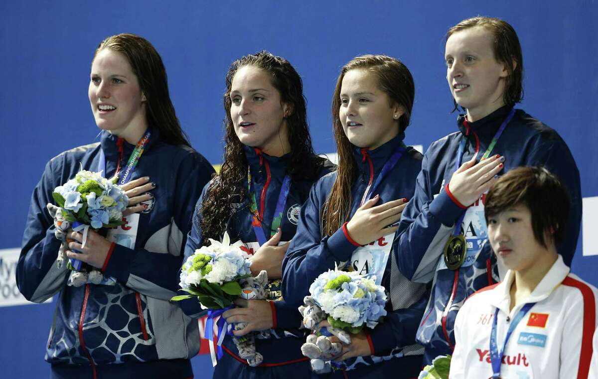 United States gold medal winners, from left, Missy Franklin, Leah Smith, Katie McLaughlin and Katie Ledecky listen to the national anthem on Thursday during the ceremony for the women's 4x200m freestyle relay final at the Swimming World Championships in Kazan, Russia.