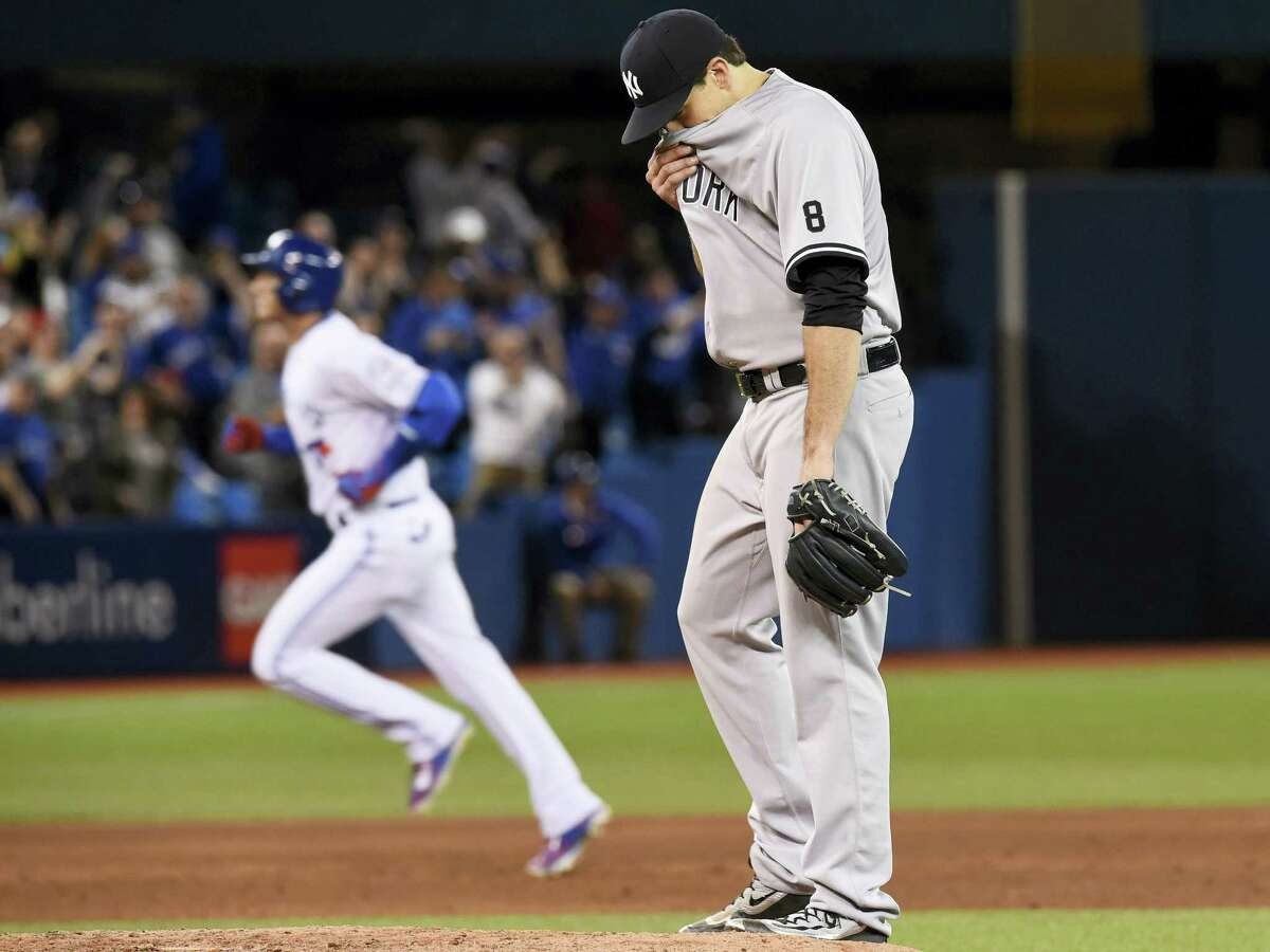 The Blue Jays' Troy Tulowitzki rounds the bases after hitting a home run against Nathan Eovaldi on Thursday.