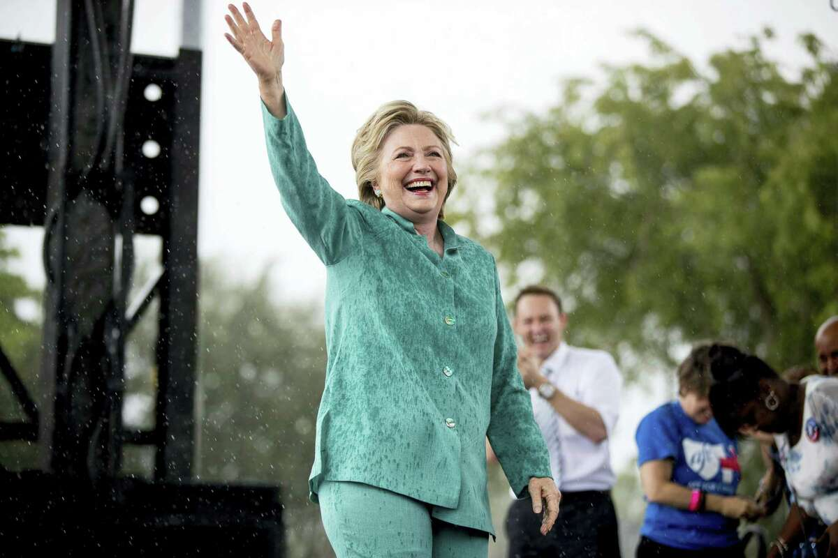 Democratic presidential candidate Hillary Clinton waves after she cut her speech short due to rain at a rally at C.B. Smith Park in Pembroke Pines, Fla. on Nov. 5, 2016.