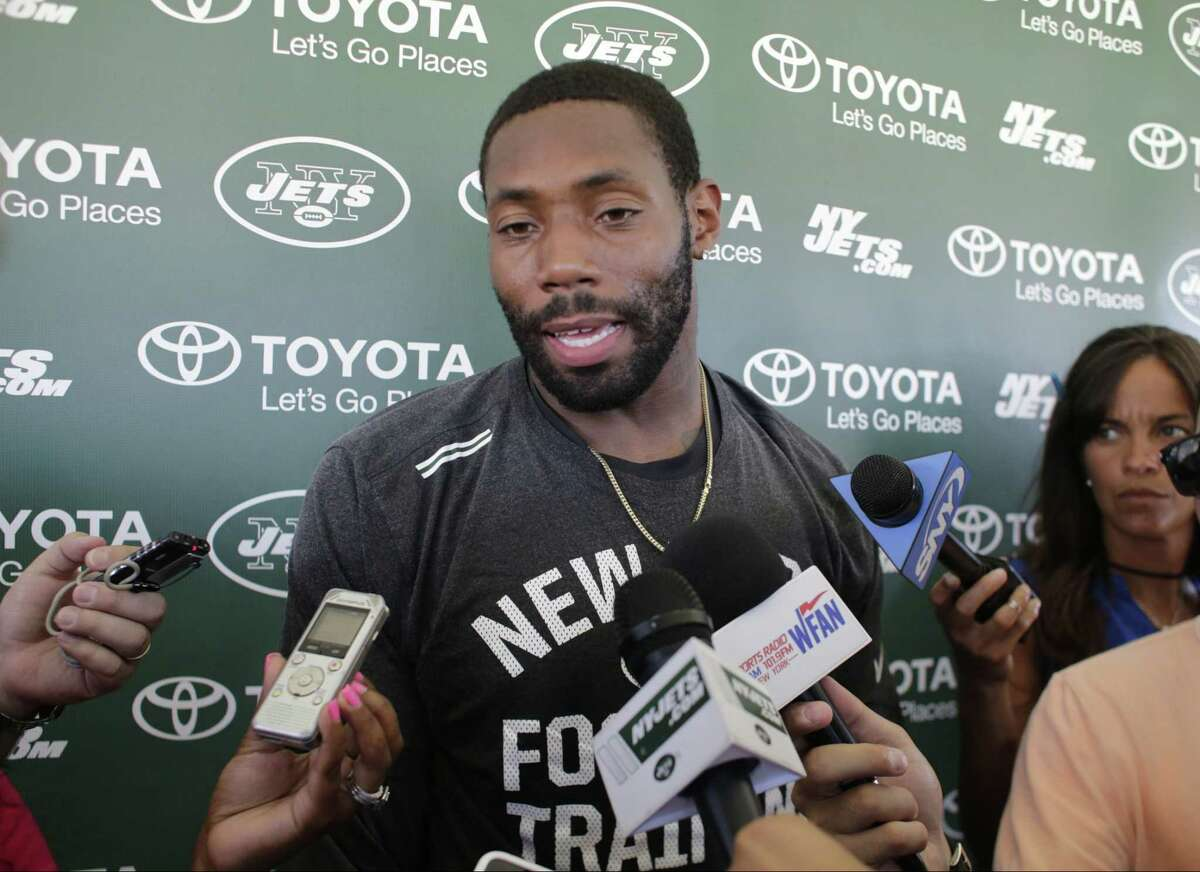 New York Jets defensive back Antonio Cromartie responds to questions during a news conference after Tuesday's practice in Florham Park, N.J.