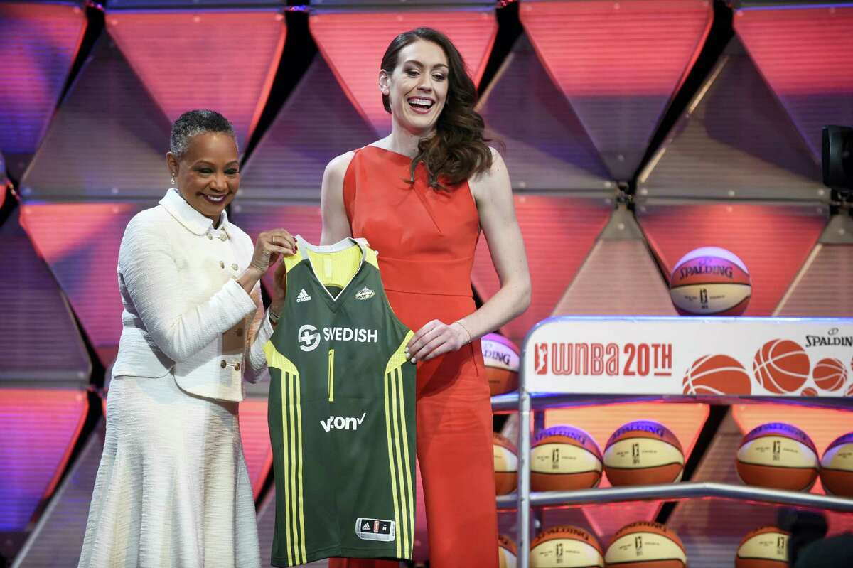 Breanna Stewart, right, and WNBA President Leslie Borders hold a Seattle Storm jersey after Stewart picked first overall by Seattle.