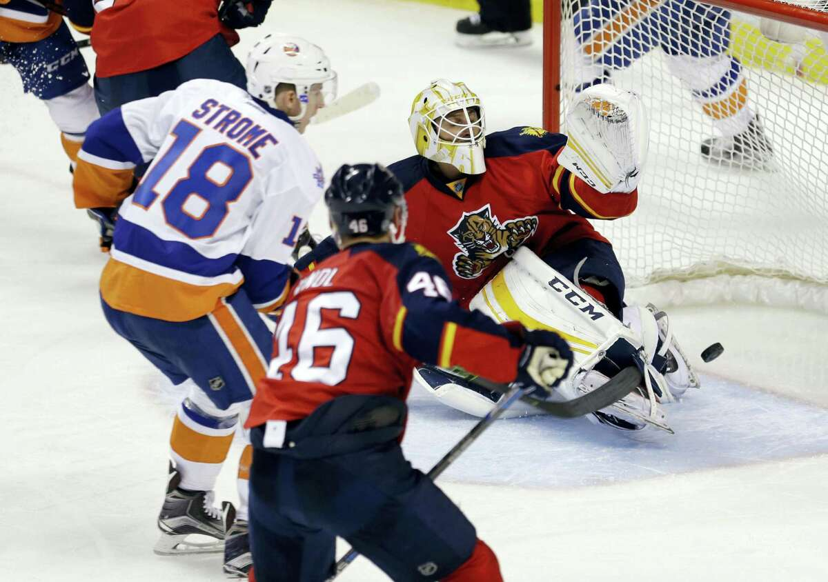 Islanders center Ryan Strome (18) scores against Panthers goalie Roberto Luongo during the third period Thursday.