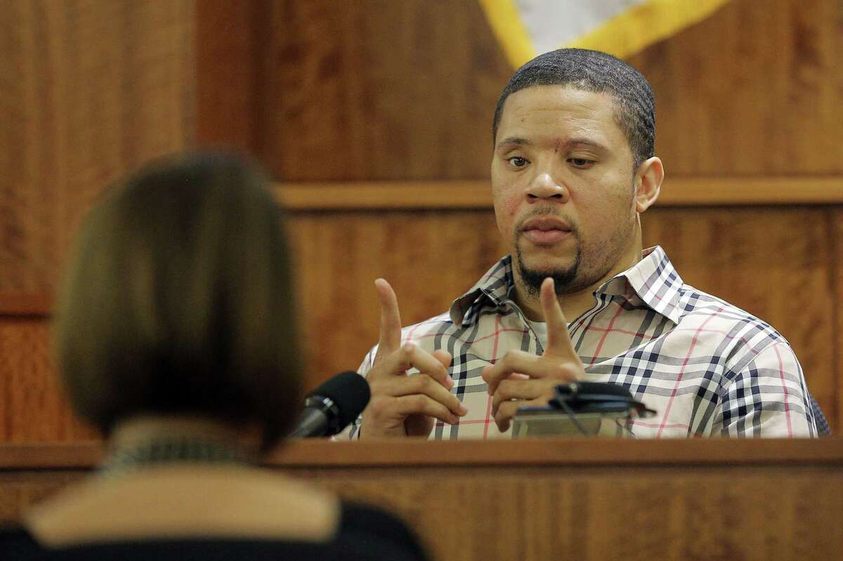 Prosecution witness Alexander Bradley describes a gun he saw with former New England Patriot Aaron Hernandez on a trip to Florida as Bradley testifies during Hernandez's murder trial on Wednesday at Bristol County Superior Court in Fall River, Mass.